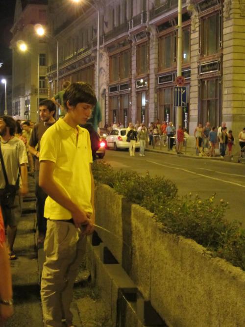 guy peeing street