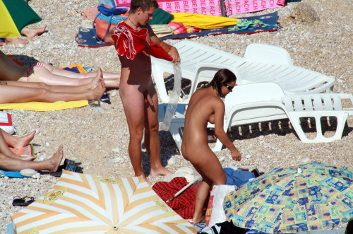 nudist couple beach