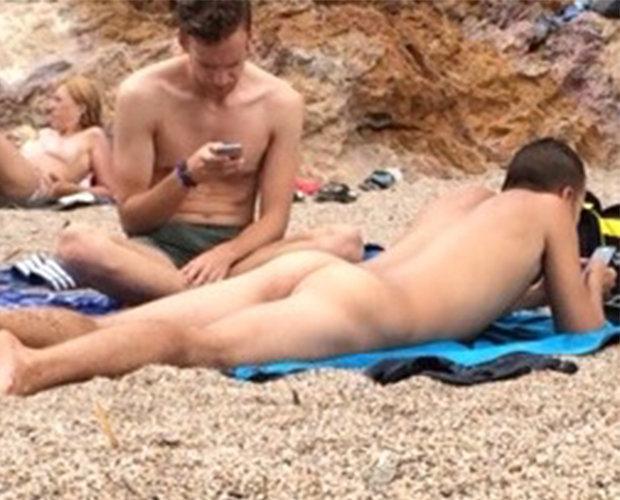 naked guy beach butt