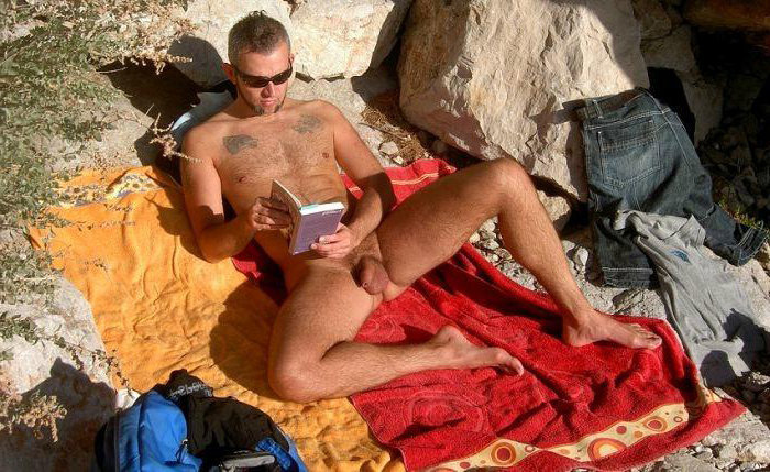 nudist man reading beach