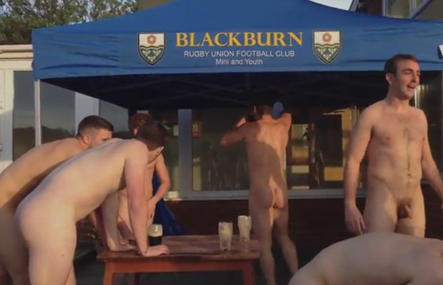 naked rugby players drinking beer