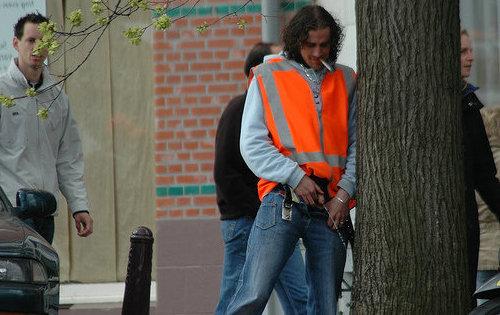 worker peeing street