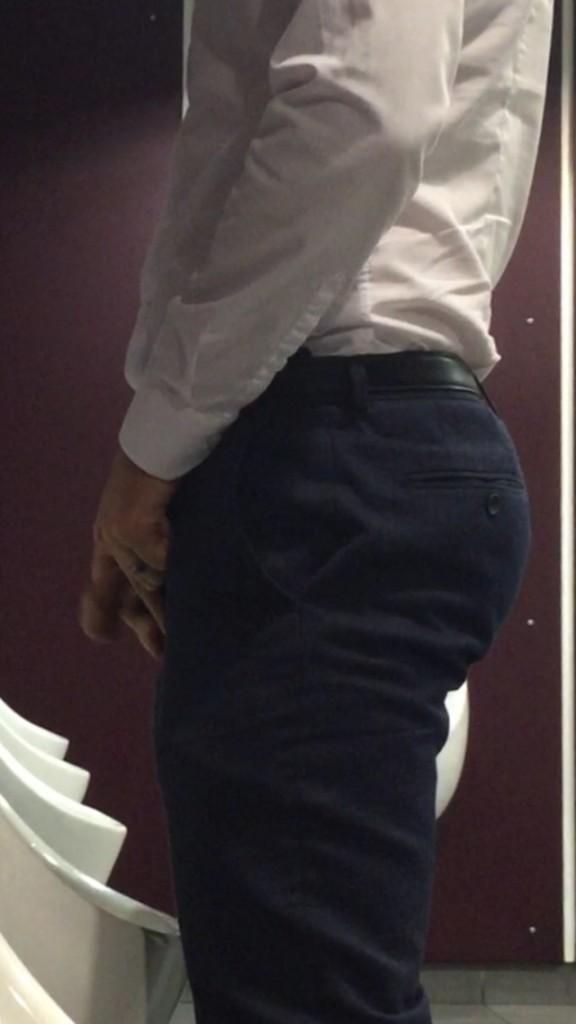 man at urinal spycam