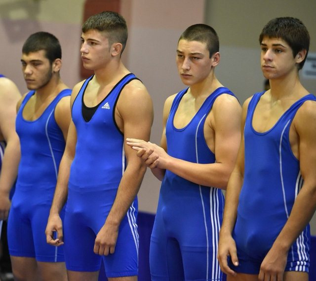 Young athletes with spandex singlets reveal their dick lines
