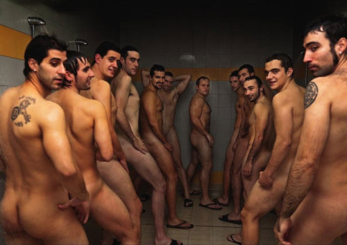 A group of naked brave sportsmen in the shower