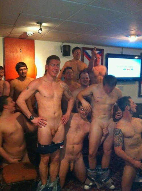 The guy in the middle holds his friend's dicks. Is him str8?