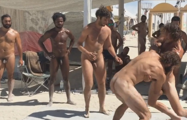 nudist men beach wrestling