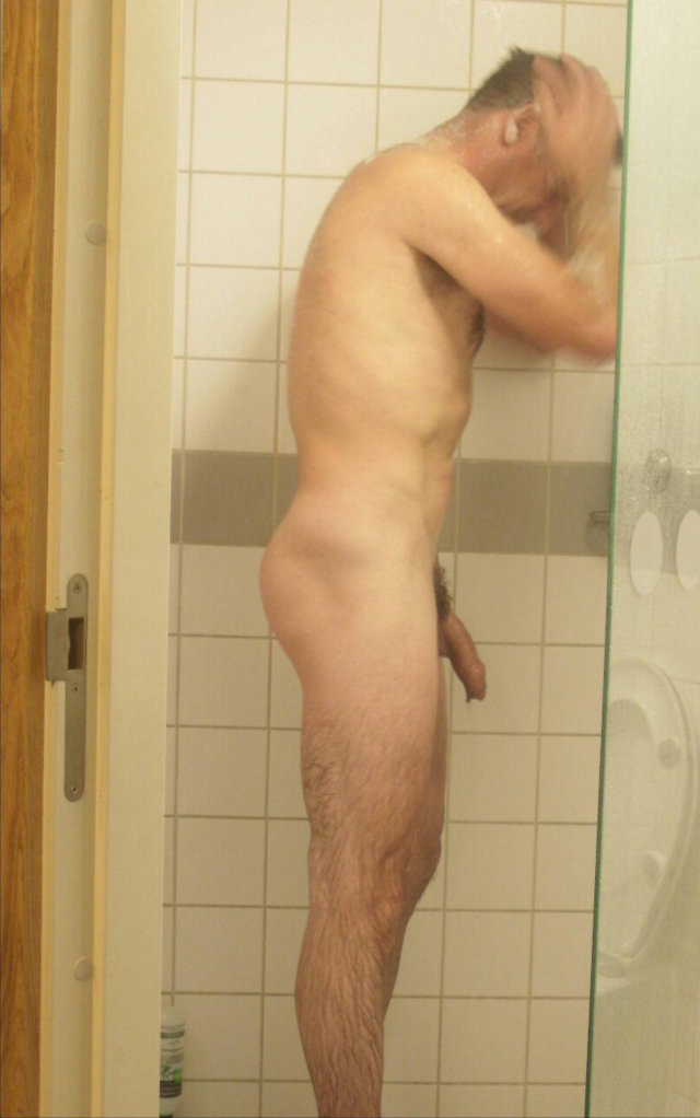 A naked woman peeing