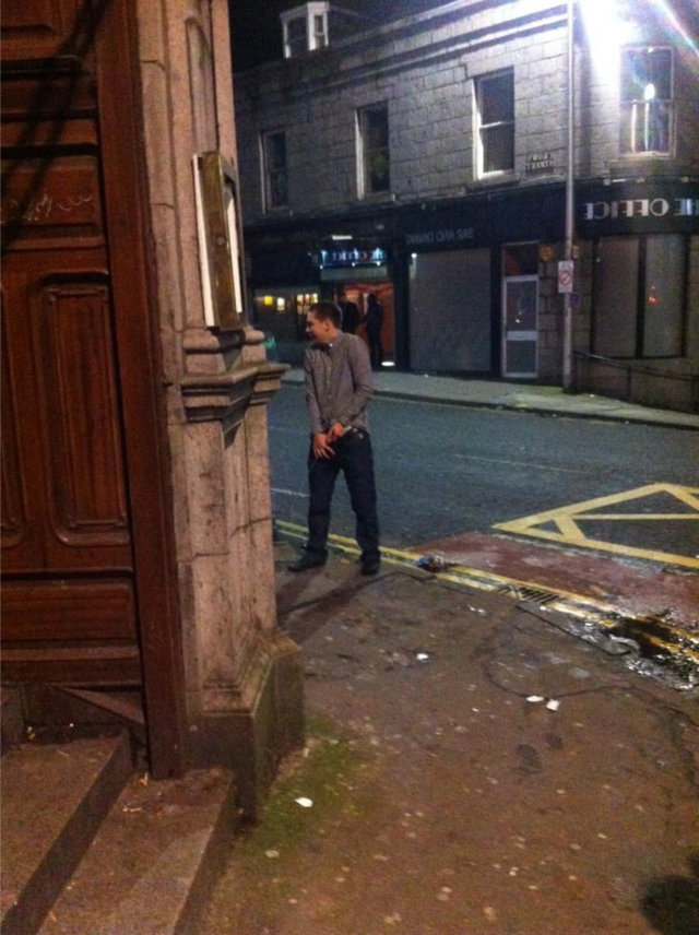 guy peeing night out