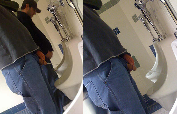 man peeing into urinals
