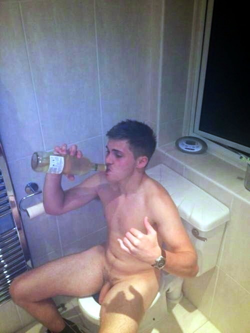 guy-drinking-wine-on-the-bowl-bathroom