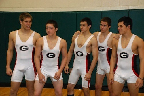Young fighters wearing spandex singlets and revealing their bulges