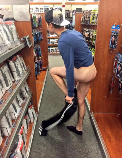 Guy caught undressing in a store