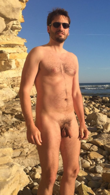 A lovely man naked on the rocks