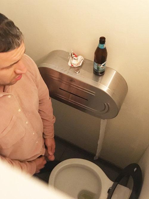 man caught peeing club toilet