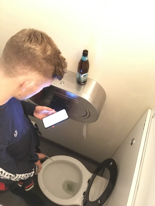 uncut guy caught pissing club toilet