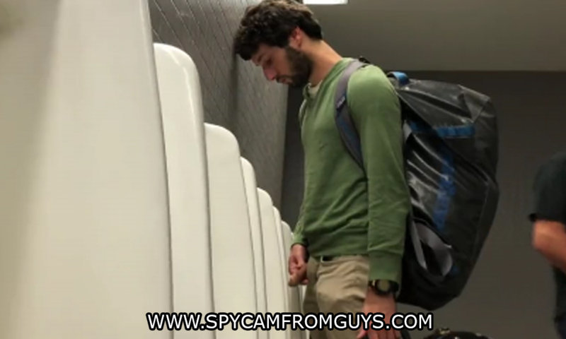 handsome guy caught peeing airport urinals