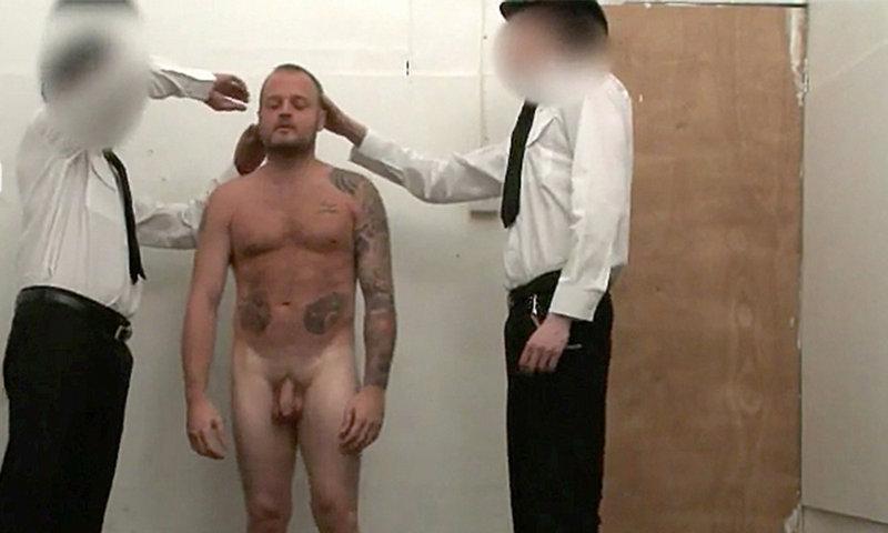 naked man body inspection police