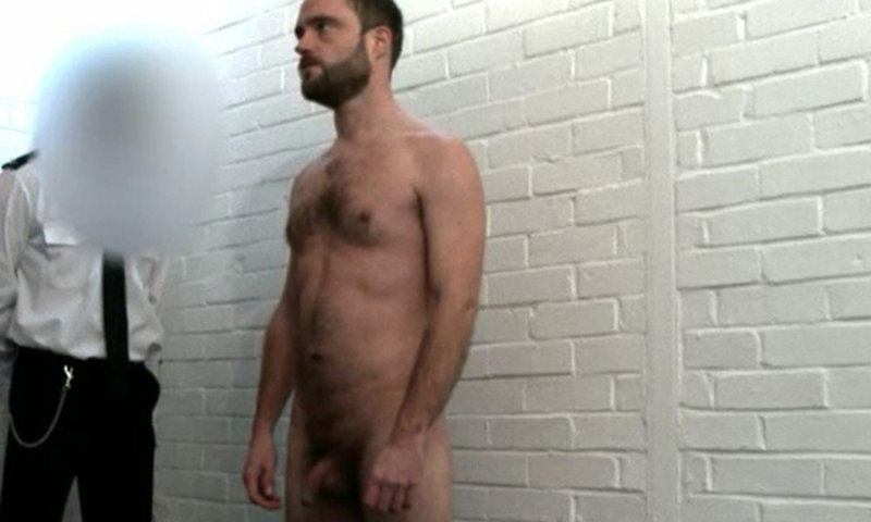 naked man in front of police officers in jail