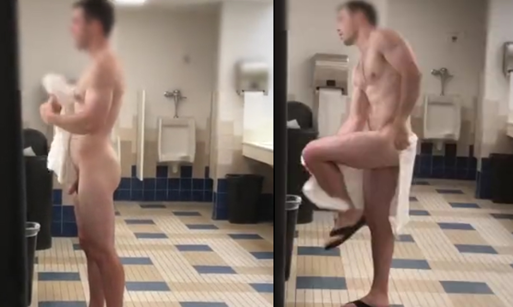naked guy drying with towel after shower in locker room