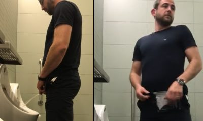 man caught peeing urinal