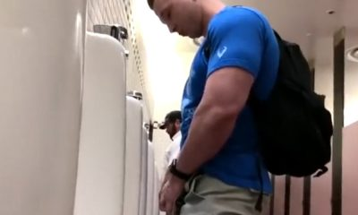 muscled stud caught peeing urinals
