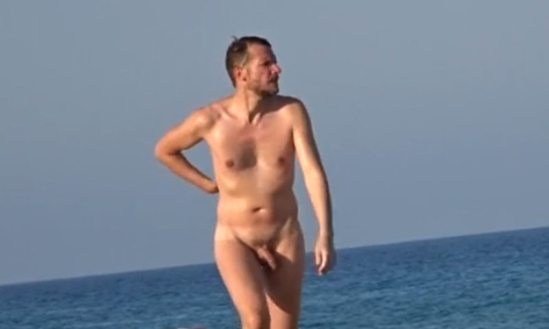 nudist man caught on the beach by a spycam