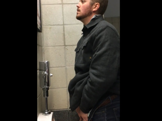 guy caught peeing at stadium urinals