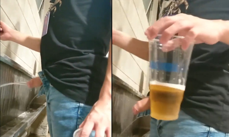 guy peeing and drinking beer at urinal