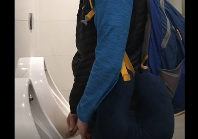 guy caught by spycam while peeing at airport urinal