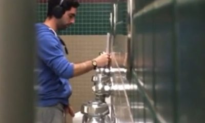 guy with huge cock caught peeing at urinal