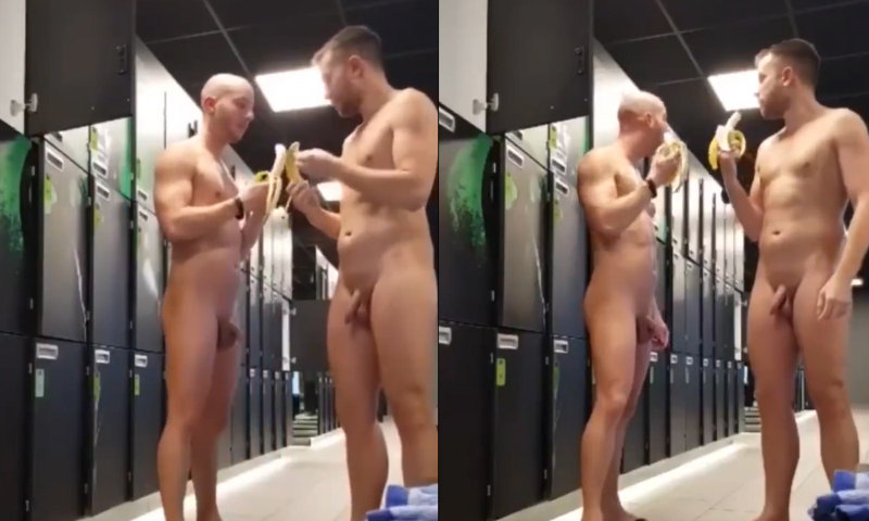 two guys naked eating banana in locker room