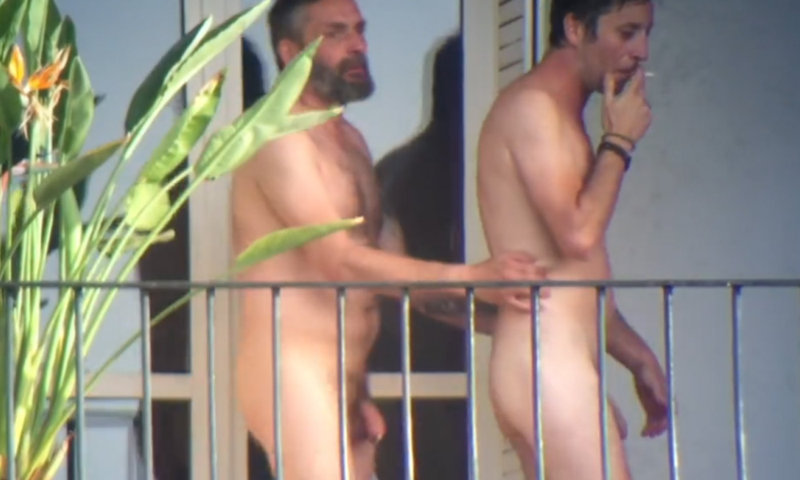 gay couple caught naked on the balcony