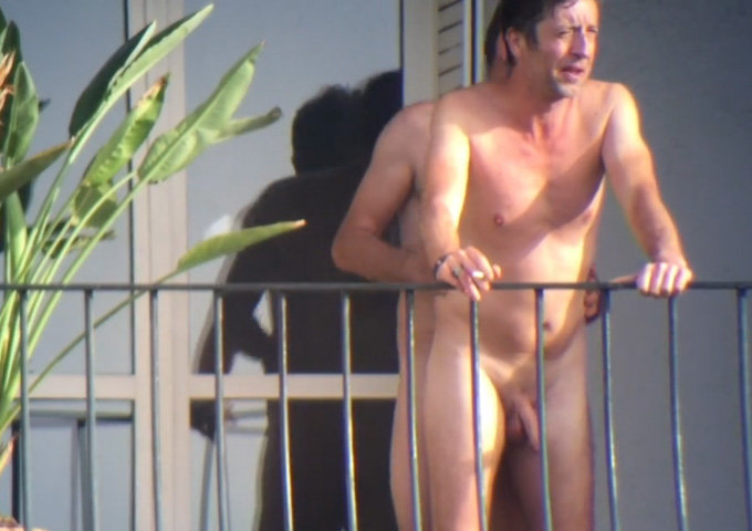 gay men caught naked and touching out on the balcony