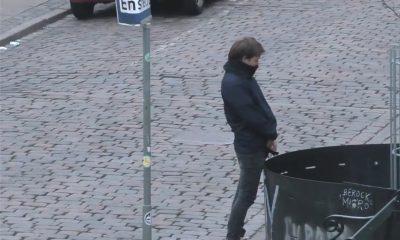 drunk man peeing in public