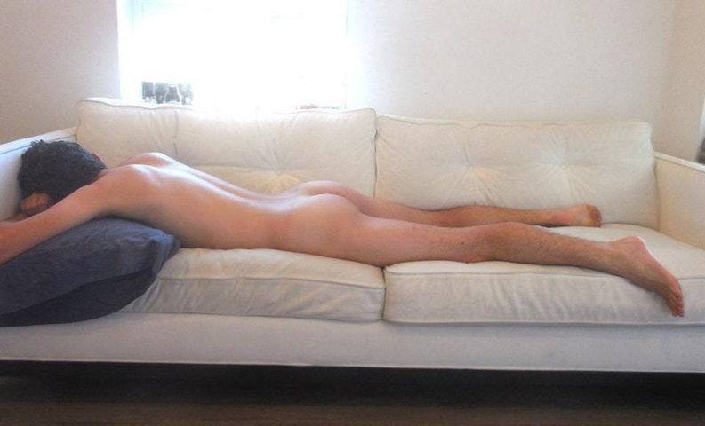 guy caught sleeping naked on the sofa