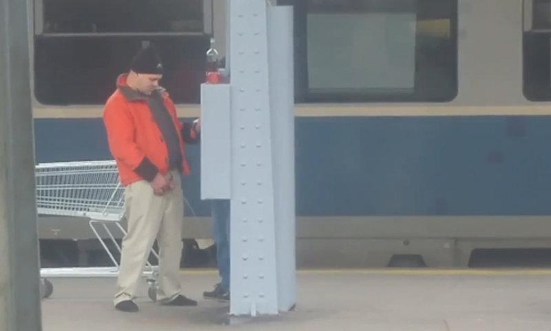 drunk man caught peeing in public
