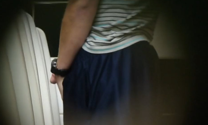 guy peeing and having a phone call at urinals