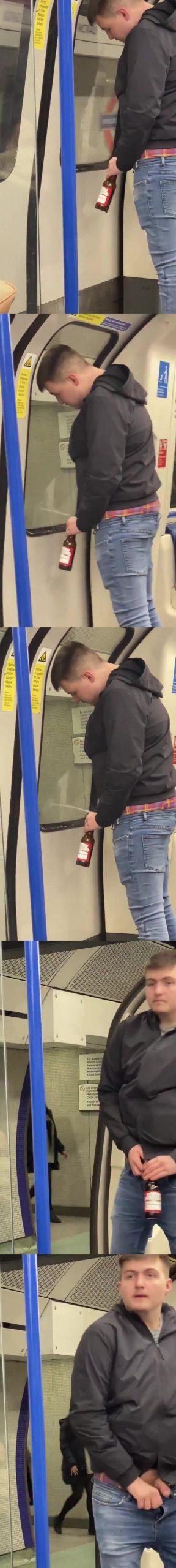 guy peeing london tube