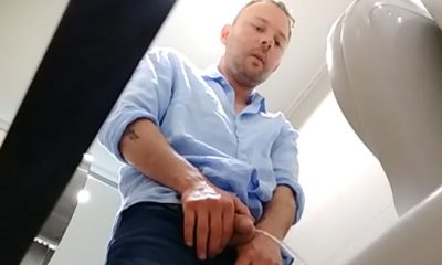 cute guy caught by spycam while peeing in public toilet