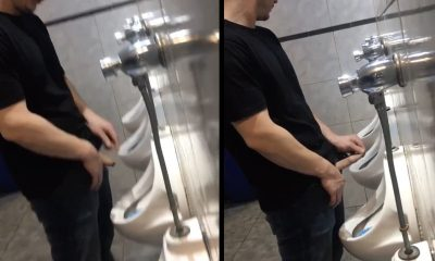 guy peeing and stretching his foresking at urinal