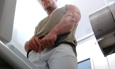 muscle stud caught peeing in public toilet
