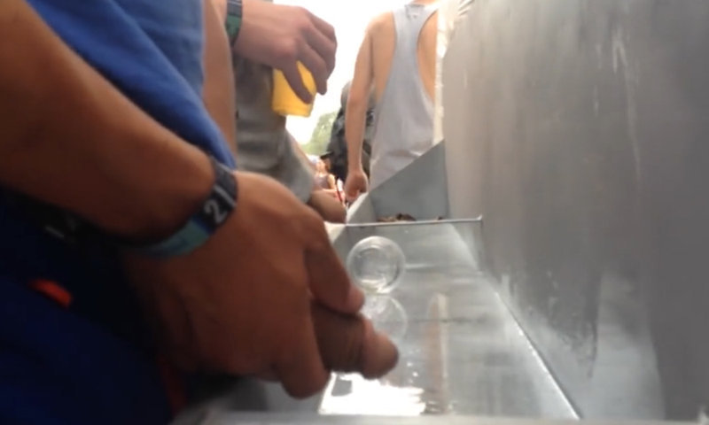 hung guys caught pissing at festival urinals