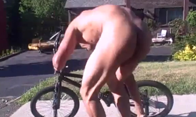 black stud riding bike naked in public