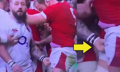 rugby player grabbing mate crotch