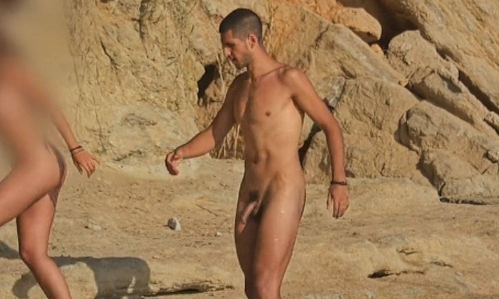 straight nudist guy with boner at the beach