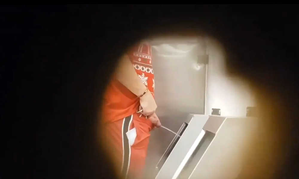 spying on hung man taking a leak at urinal