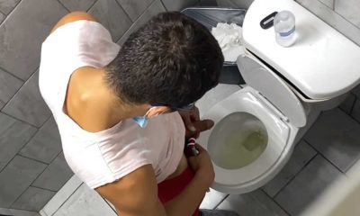 guy caught peeing from over stall in toilet