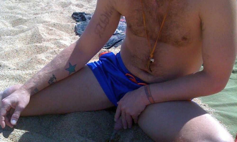 guy peeing on the beach