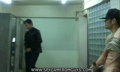 guy wanking in public toilet